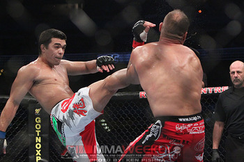 Randy Couture eating a vicious crane kick from Lyoto Machida