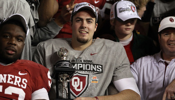 GLENDALE, AZ - JANUARY 01:  Quarterback Landry Jones #12 of the Oklahoma Sooners and offensive MVP celebrates the Sooners 48-20 victory against the Connecticut Huskies during the Tostitos Fiesta Bowl at the Universtity of Phoenix Stadium on January 1, 201