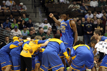 DENVER, CO - MARCH 17:  Kenneth Faried #35 of the Morehead State Eagles tries to pump his team up prior to playing against the Louisville Cardinals in the second round of the 2011 NCAA men's basketball tournament at Pepsi Center on March 17, 2011 in Denve