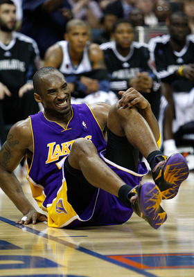CHARLOTTE, NC - MARCH 31:  Kobe Bryant #24 of the Los Angeles Lakers winces in pain after landing on his ankle wrong against the Charlotte Bobcats during their game at Time Warner Cable Arena on March 31, 2009 in Charlotte, North Carolina.  NOTE TO USER: