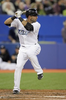 TORONTO - APRIL 12:  Jose Bautista #19 of the Toronto Blue Jays steps into the swing during the game against the Chicago White Sox at the Rogers Centre on April 12, 2010 in Toronto, Ontario. (Photo By Dave Sandford/Getty Images)