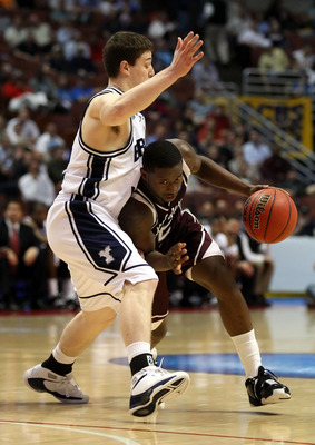 ANAHEIM, CA - MARCH 20:  Donald Sloan #15 of the Texas A&M Aggies dribbles against the defense of Jimmer Fredette of the Brigham Young Cougars during the West Region first round of the NCAA Basketball Tournament at the Honda Center on March 20, 2008 in An