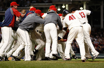 CLEVELAND - APRIL 30:  Members of the Cleveland Indians mob their teammate Orlando Cabrera #20 after he hit a walk-off game winning single in the 13th inning against the Detroit Tigers during the game on April 30, 2011 at Progressive Field in Cleveland, O