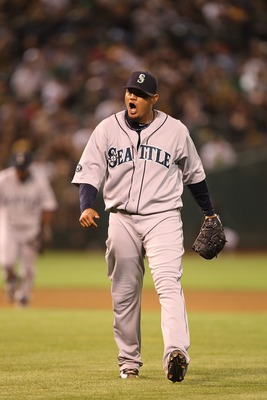 OAKLAND, CA - APRIL 01:  Felix Hernandez #34 of the Seattle Mariners celebrates at the end of the eighth inning against the Oakland Athletics during an opening day game of Major League Baseball at the Oakland-Alameda County Coliseum on April 1, 2011 in Oa