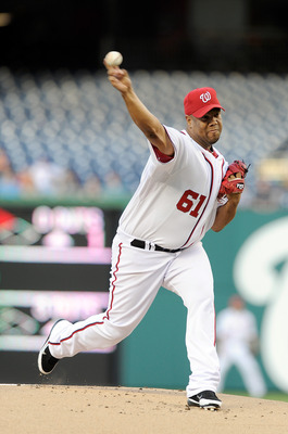 WASHINGTON, DC - APRIL 28:   Livan Hernandez #61 of the Washington Nationals pitches against the New York Mets at Nationals Park on April 28, 2011 in Washington, DC.  (Photo by Greg Fiume/Getty Images)