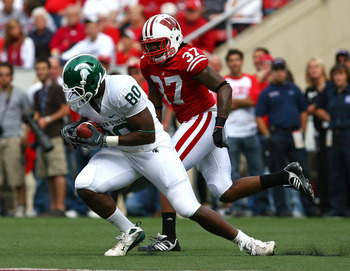 MADISON, WI - SEPTEMBER 26:  Dion Sims #80 of the Michigan State Spartans makes a catch in front of Kevin Claxton #37 of the Wisconsin Badgers on September 26, 2009 at Camp Randall Stadium in Madison, Wisconsin. Wisconsin defeated Michigan State 38-30. (P