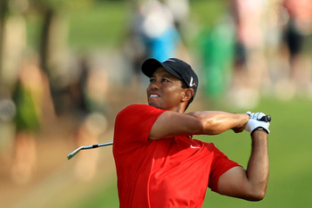AUGUSTA, GA - APRIL 10:  Tiger Woods hits a shot during the final round of the 2011 Masters Tournament on April 10, 2011 in Augusta, Georgia.  (Photo by David Cannon/Getty Images)