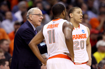 CLEVELAND, OH - MARCH 18: Head coach Jim Boeheim of the Syracuse Orange speaks to Scoop Jardine #11 and Brandon Triche #20 during the game against the Indiana State Sycamores during the second round of the 2011 NCAA men's basketball tournament at Quicken