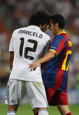 MADRID, SPAIN - APRIL 27:  Marcelo of Real Madrid and Pedro Rodriguez of Barcelona clash during the UEFA Champions League Semi Final first leg match between Real Madrid and Barcelona at Estadio Santiago Bernabeu on April 27, 2011 in Madrid, Spain.  (Photo