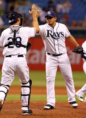 ST. PETERSBURG, FL - APRIL 18:  Pitcher Joel Peralta #62 of the Tampa Bay Rays is congratulated by catcher John Jaso #28 after getting the last three outs against the Chicago White Sox during the game at Tropicana Field on April 18, 2011 in St. Petersburg