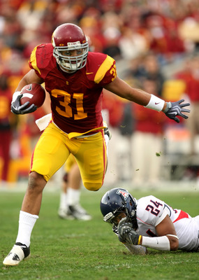 LOS ANGELES - DECEMBER 5:  Fullback Stanley Havili #31 of the USC Trojans carries the ball against the Arizona Wildcats on December 5, 2009 at the Los Angeles Coliseum in Los Angeles, California.   (Photo by Stephen Dunn/Getty Images)