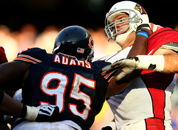 CHICAGO - NOVEMBER 08: Anthony Adams #95 of the Chicago Bears hits Kurt Warner #13 of the Arizona Cardinals at Soldier Field on November 8, 2009 in Chicago, Illinois. The Cardinals defeated the Bears 41-21. (Photo by Jonathan Daniel/Getty Images)