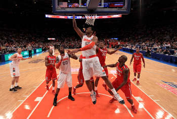 NEW YORK, NY - MARCH 10: Fab Melo #51 of the Syracuse Orange drives to the basket against the St. John's Red Storm during the quarterfinals of the 2011 Big East Men's Basketball Tournament presented by American Eagle Outfitters  at Madison Square Garden o