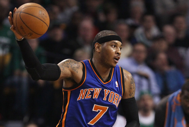 BOSTON, MA - APRIL 19:  Carmelo Anthony #7 of the New York Knicks grabs the ball in the first quarter against the Boston Celtics in Game Two of the Eastern Conference Quarterfinals in the 2011 NBA Playoffs on April 19, 2011 at the TD Garden in Boston, Mas