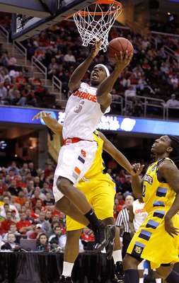 CLEVELAND, OH - MARCH 20: C.J. Fair #5 of the Syracuse Orange drives to the basket against the Marquette Golden Eagles during the third of the 2011 NCAA men's basketball tournament at Quicken Loans Arena on March 20, 2011 in Cleveland, Ohio.  (Photo by Gr