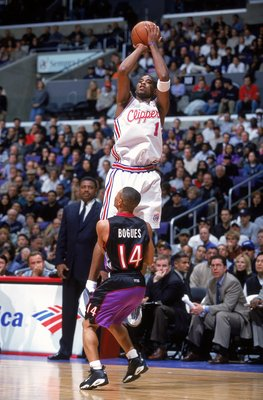 8 Mar 2000:  Derek Anderson #1 of the Los Angeles Clippers jumps to shoot the ball as Muggsy Bogues #14 of the Toronto Raptors watches him during the game at Staples Center in Los Angeles, California. The Raptors defeated the Clippers 95-94.   Mandatory C