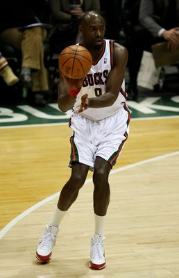 MILWAUKEE - FEBRUARY 20: Francisco Elson #9 of the Milwaukee Bucks passes the ball against the Cleveland Cavaliers on February 20, 2009 at the Bradley Center in Milwaukee, Wisconsin. The Cavaliers defeated the Bucks 111-103. NOTE TO USER: User expressly a
