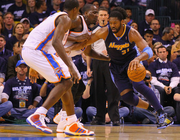 OKLAHOMA CITY, OK - APRIL 27: Nene Hilario #31 of the Denver Nuggets drives to the basket against Kendrick Perkins #5 of the Oklahoma City Thunder in Game Five of the Western Conference Quarterfinals in the 2011 NBA Playoffs on April 27, 2011 at the Ford