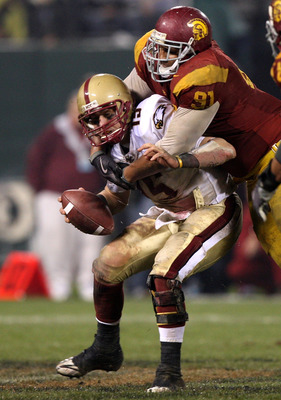 SAN FRANCISCO - DECEMBER 26: Dave Shinskie #15 of the Boston College Eagles is sacked by Jurrell Casey #91 of the USC Trojans during the 2009 Emerald Bowl at AT&T Park on December 26, 2009 in San Francisco, California. (Photo by Jed Jacobsohn/Getty Images