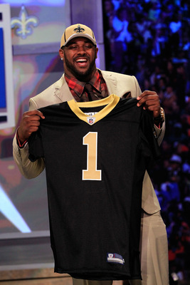 NEW YORK, NY - APRIL 28:  Cameron Jordan, #24 overall pick by the New Orleans Saints, holds up a jersey on stage during the 2011 NFL Draft at Radio City Music Hall on April 28, 2011 in New York City.  (Photo by Chris Trotman/Getty Images)