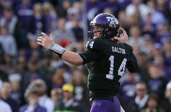 PASADENA, CA - JANUARY 01:  Quarterback Andy Dalton #14 of the TCU Horned Frogs looks to pass against the Wisconsin Badgers during the 97th Rose Bowl game on January 1, 2011 in Pasadena, California.  (Photo by Jeff Gross/Getty Images)