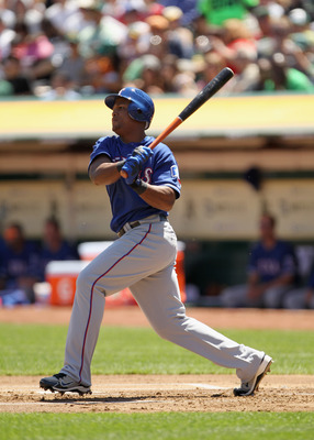 OAKLAND, CA - APRIL 30:  Adrian Beltre #29 of the Texas Rangers hits a double that scored Elvis Andrus #1 of the Texas Rangers in the first inning against the Oakland Athletics at Oakland-Alameda County Coliseum on April 30, 2011 in Oakland, California.