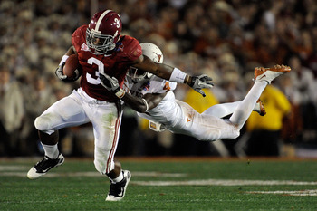 PASADENA, CA - JANUARY 07:  Running back Trent Richardson #3 of the Alabama Crimson Tide runs for an 11-yard gain after a catch as cornerback Aaron Williams #4 of the Texas Longhorns tackles him in the second quarter of the Citi BCS National Championship