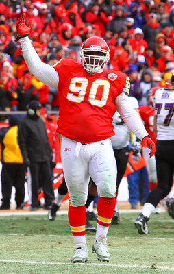 KANSAS CITY, MO - JANUARY 09:  Defensive tackle Shaun Smith #90 of the Kansas City Chiefs reacts against the Baltimore Ravens in the 2011 AFC wild card playoff game at Arrowhead Stadium on January 9, 2011 in Kansas City, Missouri.  (Photo by Dilip Vishwan