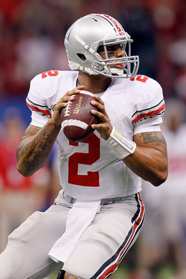 NEW ORLEANS, LA - JANUARY 04:  Quarterback Terrelle Pryor #2 of the Ohio State Buckeyes looks to pass against the Arkansas Razorbacks during the Allstate Sugar Bowl at the Louisiana Superdome on January 4, 2011 in New Orleans, Louisiana.  (Photo by Kevin