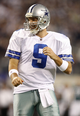 ARLINGTON, TX - JANUARY 9:  Quarterback Tony Romo #9 of the Dallas Cowboys reacts after a touchdown by wide receiver Miles Austin #19 against the Philadelphia Eagles in the first half of the 2010 NFC wild-card playoff game at Cowboys Stadium on January 9,