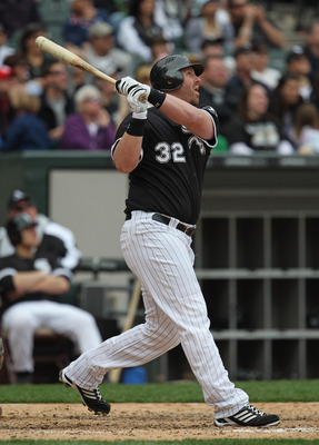 CHICAGO, IL - MAY 01: Adam Dunn #32 of the Chicago White Sox hits a pinch-hit, two-run home run in the 8th inning against the Baltimore Orioles at U.S. Cellular Field on May 1, 2011 in Chicago, Illinois. The Orioles defeated the White Sox 6-4. (Photo by J