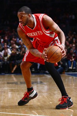 NEW YORK - JANUARY 26:  Tracy McGrady #1 of the Houston Rockets drives against the New York Knicks on January 26, 2009 at Madison Square Garden in New York City.  NOTE TO USER: User expressly acknowledges and agrees that, by downloading and/or using this
