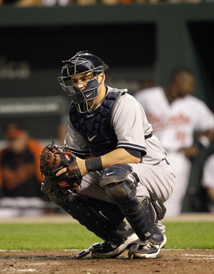 BALTIMORE, MD - APRIL 23:  Catcher Russell Martin #55 of the New York Yankees in action against the Baltimore Orioles at Oriole Park at Camden Yards on April 23, 2011 in Baltimore, Maryland.  (Photo by Rob Carr/Getty Images)