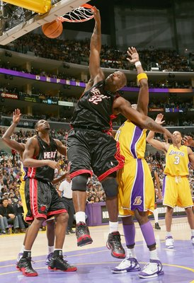 LOS ANGELES - JANUARY 16: Shaquille O'Neal #32  of the Miami Heat slam dunks against the Los Angeles Lakers on January 16, 2006 at Staples Center in Los Angeles, California. NOTE TO USER: User expressly acknowledges and agrees that, by downloading and or