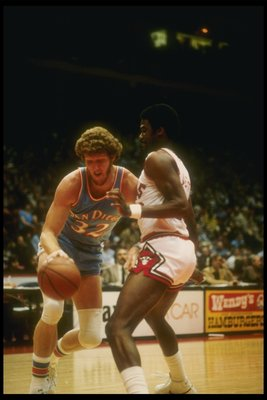 Feb 1980:  Center Bill Walton of the San Diego Clippers moves the ball during a game against the Chicago Bulls at the Sports Arena in San Diego, California. Mandatory Credit: Stephen Dunn  /Allsport
