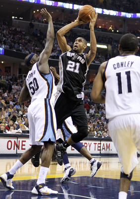 MEMPHIS, TN - APRIL 25:  Tim Duncan #21 of the San Antonio Spurs shoots the ball while defended by Zach Randolph #50 of the Memphis Grizzlies in Game Four of the Western Conference Quarterfinals in the 2011 NBA Playoffs at FedExForum on April 25, 2011 in
