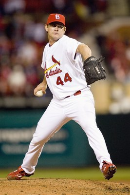 ST. LOUIS, MO - APRIL 1: Jason Isringhausen #44  of the St. Louis Cardinals delivers the pitch against the Colorado Rockies during Opening Day on April 1, 2008 at Busch Stadium in St. Louis, Missouri.    (Photo by Dilip Vishwanat/Getty Images)