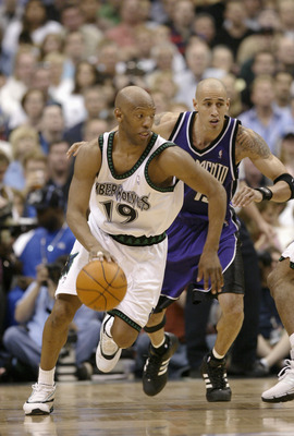 MINNEAPOLIS - MAY 8:  Sam Cassell #19 of the Minnesota Timberwolves advances the ball on the dribble as Doug Christie #13 of the Sacramento Kings gives chase in Game Two of the Western Conference Semifinals during the 2004 NBA Playoffs on May 8, 2004 at t