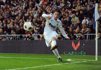 MADRID, SPAIN - MARCH 12: Mesut Ozil of Real Madrid takes a corner kick during the La Liga match between Real Madrid and Hercules CF at Estadio Santiago Bernabeu on March 12, 2011 in Madrid, Spain.  (Photo by Denis Doyle/Getty Images)