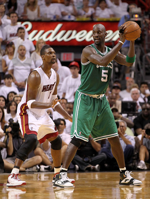 MIAMI, FL - MAY 01:  Kevin Garnett #5  of the Boston Celtics posts up Chris Bosh #1 of the Miami Heat during game one of the Eastern Conference Semifinals of the 2011 NBA Playoffs at American Airlines Arena on May 1, 2011 in Miami, Florida. NOTE TO USER: