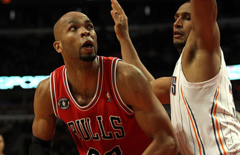 CHICAGO, IL - FEBRUARY 15: Taj Gibson #22 of the Chicago Bulls puts up a shot against Boris Diaw #32 of the Charlotte Bobcats at the United Center on February 15, 2011 in Chicago, Illinois. The Bulls defeated the Bobcats 106-94. NOTE TO USER: User express