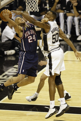 SAN ANTONIO - JUNE 6:  Richard Jefferson #24 of the New Jersey Nets shoots against the David Robinson #50 of the San Antonio Spurs during Game two of the 2003 NBA Finals at SBC Center on June 6, 2003 in San Antonio, Texas.  The Nets won 87-85.  NOTE TO US