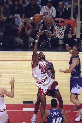 7 Jun 1998:  Dennis Rodman #91 of the Chicago Bulls goes for the rebound as Adam Keefe #31 of the Utah Jazz watches during the NBA Finals game 3 at the United Center in Chicago, Illinois.  The Bulls defeated the Jazz 96-54. Mandatory Credit: Jonathan Dani