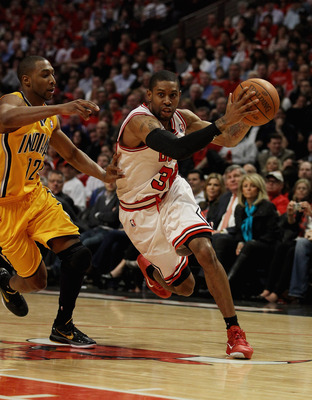CHICAGO, IL - APRIL 26: C.J. Watson #32 of the Chicago Bulls drives past A.J. Price #12 of the Indiana Pacers in Game Five of the Eastern Conference Quarterfinals in the 2011 NBA Playoffs at the United Center on April 26, 2011 in Chicago, Illinois. The Bu