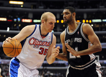 LOS ANGELES, CA - DECEMBER 13:  Chris Kaman #35 of the Los Angeles Clippers dribbles to the basket in front of Tim Duncan #21 of the San Antonio Spurs at Staples Center on December 13, 2009 in Los Angeles, California.  NOTE TO USER: User expressly acknowl