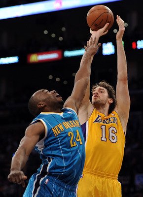 LOS ANGELES, CA - APRIL 26:  Pau Gasol #16 of the Los Angeles Lakers shoots over Carl Landry #24 of the New Orleans Hornets in the first quarter in Game Five of the Western Conference Quarterfinals in the 2011 NBA Playoffs on April 26, 2011 at Staples Cen