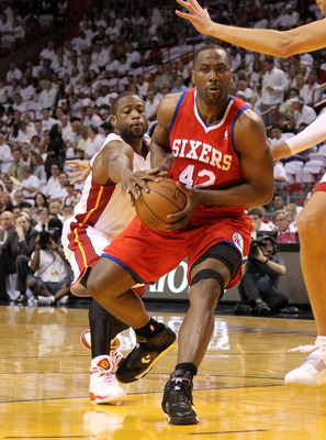 MIAMI, FL - APRIL 27:  Elton Brand #42 of the Philadelphia 76ers drives to the rim past Dwyane Wade #3 of the Miami Heat during game five of the Eastern Conference Quarterfinals in the 2011 NBA Playoffs at American Airlines Arena on April 27, 2011 in Miam