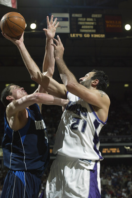 SACRAMENTO, CA - MAY 15:  Vlade Divac #21 of the Sacramento Kings shoots a layup against Raef LaFrentz #45 of the Dallas Mavericks in Game six of the Western Conference Semifinals during the 2003 NBA Playoffs at Arco Arena on May 15, 2003 in Sacramento, C