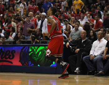 INDIANAPOLIS, IN - APRIL 23: Derrick Rose #1 of the Chicago Bulls limps down the court after injuring his ankle against the Indiana Pacers in Game Four of the Eastern Conference Quarterfinals in the 2011 NBA Playoffs at Conseco Fieldhouse on April 23, 201