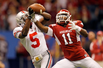 NEW ORLEANS, LA - JANUARY 04:  Chimdi Chekwa #5 of the Ohio State Buckeyes is unable to come up with an interception as he goes up for the ball against Cobi Hamilton #11 of the Arkansas Razorbacks in the second quarter during the Allstate Sugar Bowl at th